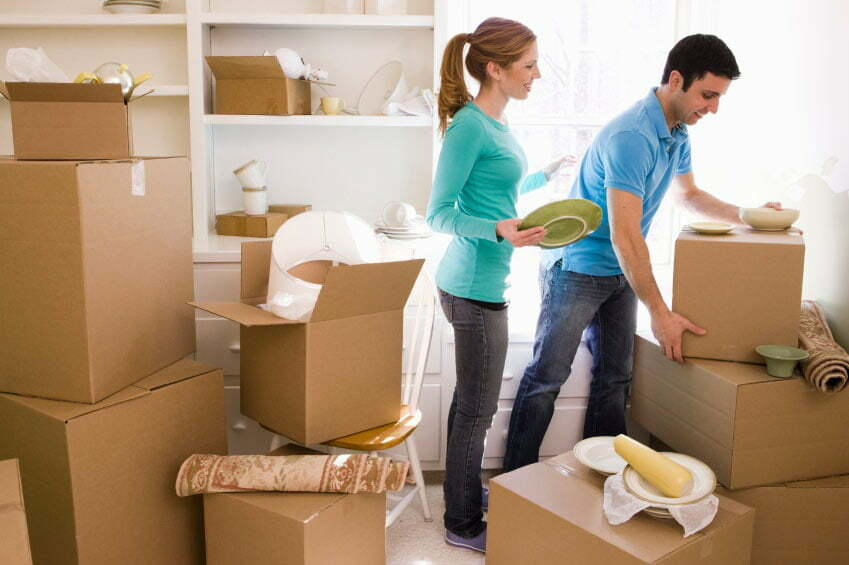 couple-unpacking-surrounded-by-boxes-1